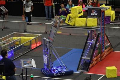 Bowser in action at the FIRST Competition. Making a robot that can stack boxes up on an elevated scale is harder than you'd think. (Image courtesy of Grant Butsumyo.)
