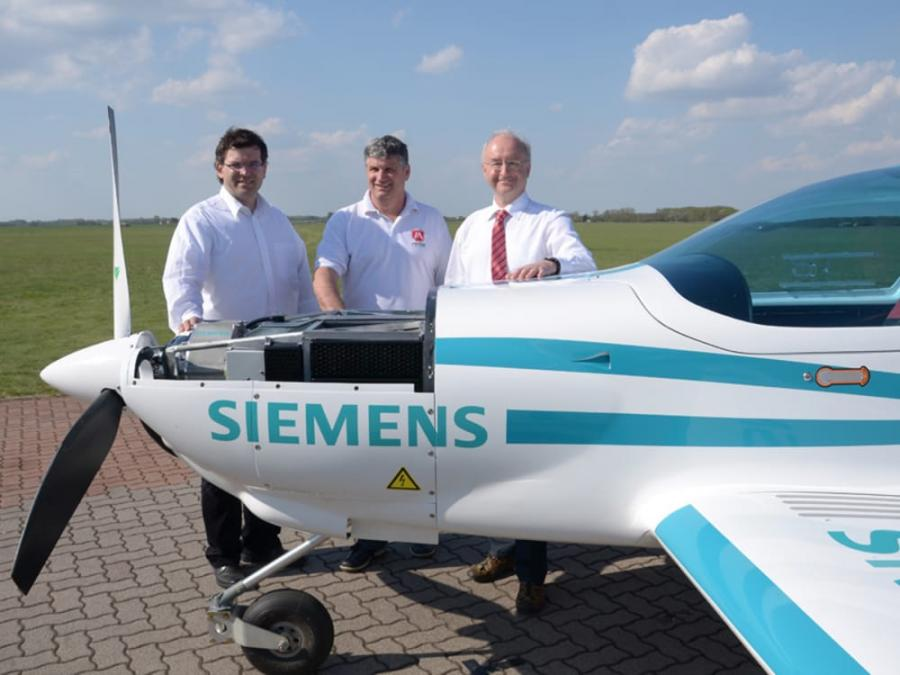 An eFusion aircraft with company executives in happier times.