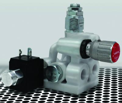 This 3D-printed hydraulic valve block is made of stainless steel for controlling a single-acting cylinder. The process uses a computer-controlled laser to melt stainless steel powder layer by layer.