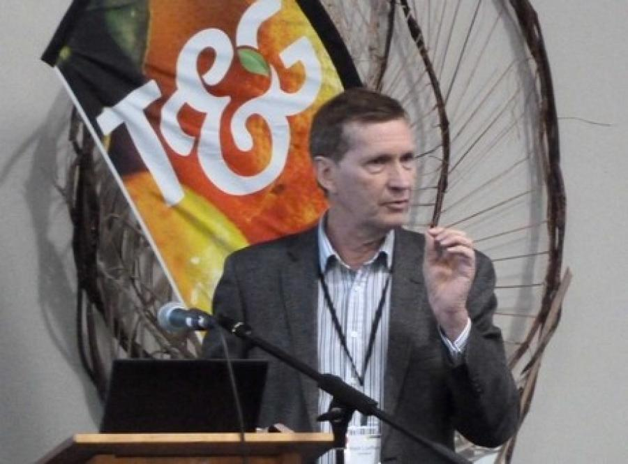 Mark Loeffen speaking at a NZCGI Conference.