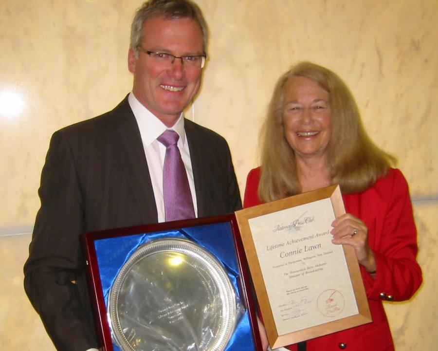 Miss Lawn is photographed in The Beehive in 2006 receiving her National Press Club Lifetime Achievement Award from Minister of Broadcasting Steve Maharey.