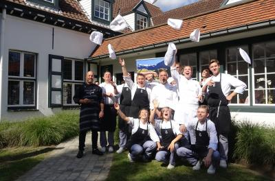 Trainee Belgian chefs celebrate what they have learned about NZ venison from NZ chefs Graham Brown (centre) and Shannon Campbell (far left)