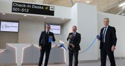 Cutting the ribbon at the opening of the new check-in area were: London Stansted's Brad Miller, Chief Operating Officer; John Farrow, Customer Service & Security Director; and Paul Willis, Transformation Director.