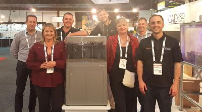 """The CADPRO Team at their stand at Emex18 with Richard from Markforged. From Left: Peter Crawley, Patricia Monteiro, Scott Moyse, Richard Elving ( Markforged ), Trish Malcolm, Matthew Weake, Gavin Bath"