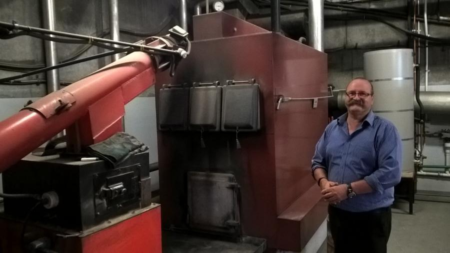 Ara Timaru Facilities Manager Roger Luscombe with the wood boiler that heats the campus and reduces CO2 emissions.