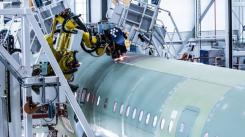 Airbus' newest final assembly line in Hamburg, includes two seven-axis robotic arms that perform precise fuselage drilling. (Airbus)