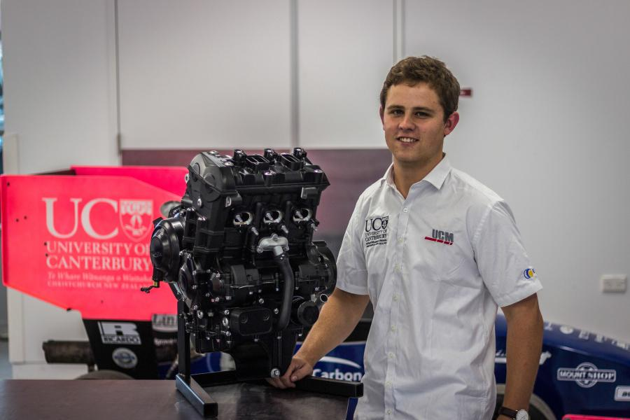 UC Motorsport team principal Jacob Ewing with one of the Triumph Daytona 675R engines that the students will be using to build their Formula Student race car.